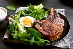 Pork steak with green salad. Close up view Stock Image