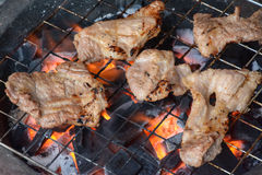 Pork steak on the grill with flames Royalty Free Stock Photography