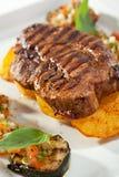 Pork Steak. Grilled Foods - BBQ Pork on Potato with Vegetables Royalty Free Stock Images