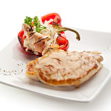 Pork Steak. Grilled Foods - BBQ Pork with Stuffed Bell Pepper Stock Images