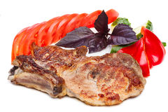 Pork steak. Grilled pork steak isolated on white. Steak BBQ. Hearty steak dinner with vegetable garnish Stock Photo