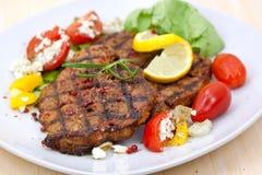 Pork steak,grilled with salad stock image