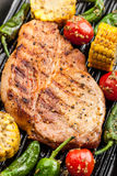 Pork steak with grilled vegetables Stock Photos