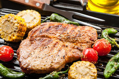 Pork steak with grilled vegetables Royalty Free Stock Photos