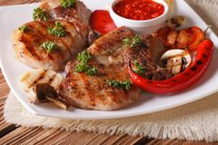 Pork steak with grilled vegetables on plate close-up, horizontal Royalty Free Stock Image