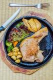 Pork steak. In hot pan Stock Photography