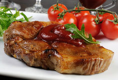 Pork steak with ketchup Stock Photo