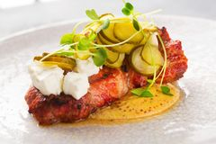 Pork steak with marinated cucumber and cheese feta Stock Photography
