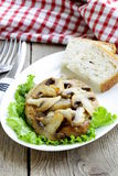 Pork steak with mushroom sauce Stock Photos