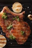 Pork steak with onion macro in a pan grill. vertical top view Stock Images