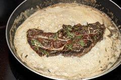 Pork steak in pan Royalty Free Stock Photography