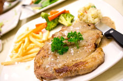 Pork Steak with Pepper Creame Sauce on White Dish Royalty Free Stock Images