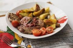 Pork steak with potato Stock Photography