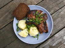 Pork steak with potatoes and bread. Stock Photo