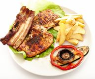 Pork steak, potatoes and vegetables Royalty Free Stock Image