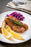 Pork steak with red cabbage and mashed potatoes. On white plate royalty free stock photos