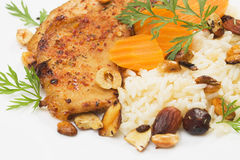 Pork steak with rice, carrot and roasted nuts Stock Images