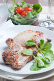 Pork steak with salad Stock Photos