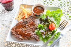 Pork steak. This is pork steak with salad Royalty Free Stock Image
