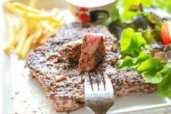 Pork steak with salad. Eating pork steak with salad Stock Photos