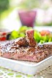 Pork steak with salad. Eating pork steak with salad Royalty Free Stock Images