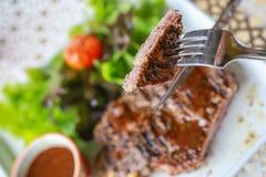 Pork steak with salad. Eating pork steak with salad Royalty Free Stock Image