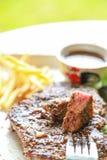 Pork steak with salad. Eating pork steak with salad Stock Photo