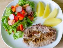 Pork steak with salad and potatoes Royalty Free Stock Photo