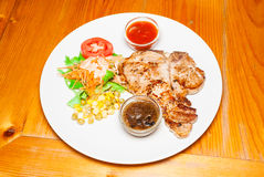 Pork Steak with Salad Royalty Free Stock Photography