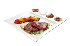 Pork steak with sauces and vegetables. On a white background stock images