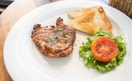 Pork steak and toast Stock Photography
