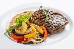 Pork steak with vegetable garnish stock image
