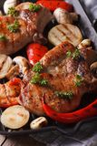 Pork steak with vegetables on  grill. vertical top view macro Royalty Free Stock Images