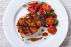 Pork steak with vegetables and sauce top view horizontal Stock Photos