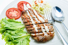 Pork Steak with Vegetables.on White Background. Royalty Free Stock Images