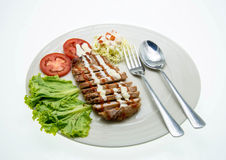 Pork Steak with Vegetables.on White Background. Royalty Free Stock Photography