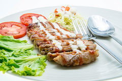 Pork Steak with Vegetables.on White Background. Royalty Free Stock Photos