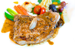 Pork steak. With vegetables on white plate Royalty Free Stock Photos
