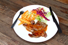 Pork Steak. On a white plate Stock Images