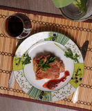 Pork steak and wine. Pork steak on the plate witn wine Royalty Free Stock Photography
