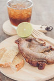 Pork steak on wooden plate Royalty Free Stock Images