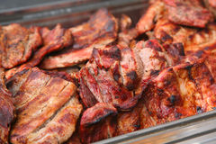 Pork steaks. Bowl with fresh baked pork steaks Royalty Free Stock Images