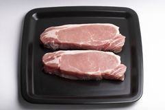 Pork steaks Royalty Free Stock Images