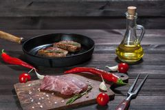 Pork steaks on cutting board. Ready to cooking. Fresh raw meat, wooden background, selective focus Royalty Free Stock Image