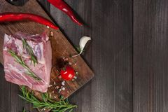 Pork steaks on cutting board. Ready to cooking. Fresh raw meat, wooden background, selective focus Royalty Free Stock Photos