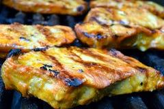 Pork steaks on a grill Stock Photos