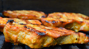 Pork steaks on a grill Royalty Free Stock Photo