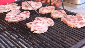 Pork steaks on the grill stock footage