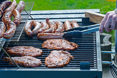Pork steaks and grilled sausage Stock Image