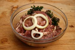 Pork steaks marinated in oil Stock Images